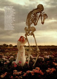 flower fields, red hair, large skeleton. Tim Walker.