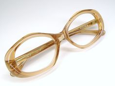 Very beautiful pair of unique peach big lens eye wear. The brand is Peerage frame Austria. They are in excellent vintage condition. NOS (New Old Stock). Very nice frames. Clean strong five barrel hinges. They have no lens in. Ready to have your Rx or sunglasses lens put in. Please ask any questions. I have more eyeglasses listed.Check out my shop for more unique vintage eyewear. http://www.etsy.com/shop/Vintage50sEyewear      Lens size - 52mm  Bridge size -16mm  Temple Length-5 1/2  Across…
