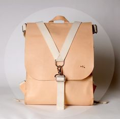 A gorgeous natural vegetable-tanned leather backpack, available for $300 from Materials + Process on Etsy.