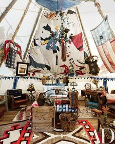 A remnant of an original chief's tepee hangs over the Victorian cast-iron bed, which is topped with antique bedding and Ralph Lauren Home shams; the chandelier is also Victorian. Architectural Digest, Bedford New York, Tenda Camping, Colorado Ranch, Telluride Colorado, Colorado Usa, Cast Iron Beds, Deco Cool, New York Homes