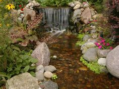 Waterfall created by R & A Water Features and Landscaping in Otsego, MI. #WaterfallWednesday