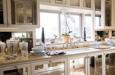 "Inside the stunning home of the Ultimate A-list decorator: Alex Papachristidis. Panels of antique mirror make the kitchen sparkle. ""I wanted my kitchen to feel like a big bar,"" Alex says. Photo by Lesley Unruh. One Kings Lane Designer Houses."
