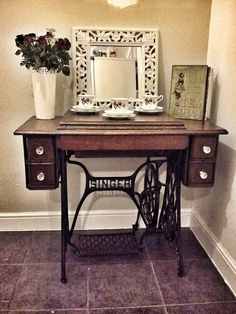 singer sewing machine table . Picture display, maybe? Like, ancestors photos? :) (My great great grandmother had a singer sewing machine table like this, which we had in our house when I was growing up....I used to pump my foot on the pedal and pretend I was sewing, back when I was a little kid. lol.)