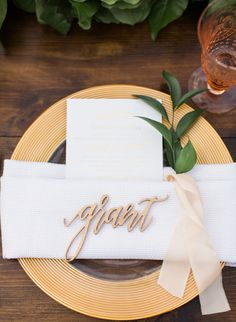 Laser-cut names serve as escort cards for the wedding reception   Tips for Making a Big Wedding Feel Intimate - Inspired by This