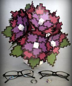 8 Bit Flowers. Thinking this would make a silly centerpiece. Let our guests know we are definitely geeks!