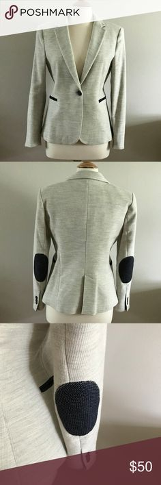 Zara Blazer Stylish marled gray blazer with dark blue and white elbow patches and pocket trim. One button styling. Fully lined. EUC -- worn once or twice.  Label marked as US XL but it is sized more like a M/L. Zara Jackets & Coats Blazers