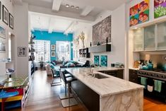 This loft is located in New York, I'm sorry for not knowing who the author is as the interior is so amazing! The open plan and giant windows make the space look bigger. The colors are fresh and bright but not redundant – turquoise blue accents make the space light. The interior is very functional and modern, there is much light and many pop-art pictures to adorn the space. The master's bedroom is done in beige and warm yellow, the kid's room is bright pink with everything necessary for the…