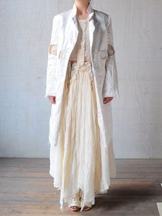 London based designer Elena Dawson creates beautiful garments and accessories that posses an ephemeral quality that is meticulous yet timeless....