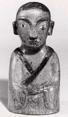 Buddhist statue of a nahan. Stoneware with iron-brown decoration under celadon glaze. Dimensions: H: 17.8 cm; W: 8.6 cm; D: 7 cm. Credit Line: Gift of Edna Bahr, 1962 Accession Number: 62.97.9, The Metropolitan Museum of Art.