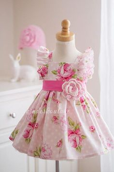 Evelyn is a gorgeous pink girls handmade floral dress. This vintage style inspired pattern is full of beautiful details such as flutter sleeves, a solid pink sash, and a classic style bodice that buttons in the back. Toddler Dress, Baby Dress, Little Girl Dresses, Girls Dresses, Fairytale Dress, Vintage Dress Patterns, Gingham Dress, Red Gingham, Rose Dress