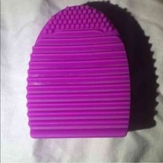 Fuchsia purple Brushegg makeup brush cleaner new Selling a mint blue brush egg. Used to clean your dirty makeup brushes! Just add soap to the egg and move the brush up and down! 3x3x1 inches 100% silicone   Colors available: light purple, hot pink, fuchsia purple, mint blue Makeup Brushes & Tools