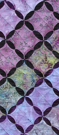 Layers of Lavender is an original design variation of a cathedral window quilt