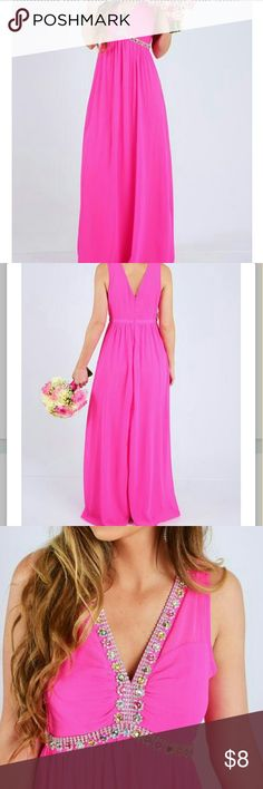 Save The Date Maxi:Hot Pink Brighten up your bridal party with our ?Save The Date Maxi Dress?! Fitted, semi-sheer hot pink floor length maxi dress that?s fully lined, made from a lightweight polyester material and features a true-to-size fit, a plunging v-neckline, a v-cut back, rhinestones and alternating colored iridescent stones adorning the front straps, bodice, and front waist, a fitted waist leading to a flowing semi-sheer skirt that?s fully lined, and a hidden zipper and hook and eye…