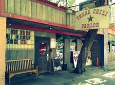Well I wish I was in Austin/ At the Chili Parlor Bar/ Drinking Mad Dog Margaritas