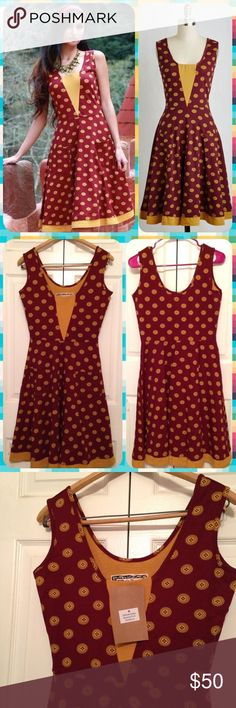 NWT ModCloth Buttons Print Effie's Heart Dress New with tag size Medium dress by Effie's Heart with a fun buttons print.  Crimson maroon ish red and gold buttons make up the design - great for Fall and Winter with a cardigan!  The material is a very stretchy cotton & spandex blend.  Great reviews for this Sailboat Load of Fun nautical style dress on ModCloth!  This dress also seems like it would be a good one to show your team spirit if your favorite school, college, or pro football team…