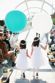 Add whimsy to a traditional #wedding party by giving flower girls balloons instead of bouquets!