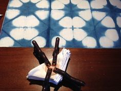 Itajime Shibori: shows folded and clamped fabric, and results after indigo dyed