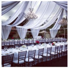 An elegant open air wedding reception on the Croquet Lawn, featuring streaming pure white drapes and glistening crystal chandeliers. ‪#‎Stunning‬ ‪#‎Love‬ ‪#‎Wedding‬ ‪#‎RanchoSantaFe‬ — at The Inn at Rancho Santa Fe.