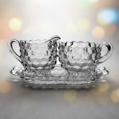 Fostoria American Individual Cream and Sugar Set. This Set includes a Handled Tray, which has a measurement of about from handle to handle.