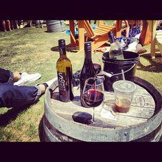 Wine bottles and a barrel at Malibu Wines