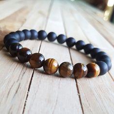 Check out this item in my Etsy shop https://www.etsy.com/listing/475027844/810-mm-tiger-eye-bracelet-men-women-yoga