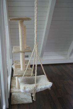 Scratching post with a hammock