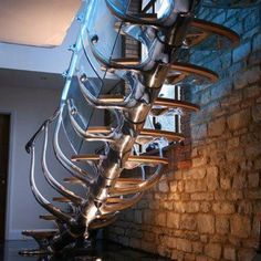 Amazingly strange and oh how I love this staircase sculpted to mimick a vertibral column!   Courtesy of Architecture Daily.