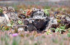 Sniper of Navy SEALs in training.