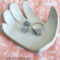 Make a darling little clay handprint jewelry dish for a Mother's Day gift!! It's so easy and there is NO baking required! Supplies Needed: Air-dry clay Knife Bowl Start by rolling out clay flat then stamp your child's handprint in it making a deep print. Take an x-acto knife and cut around the outside. Drape …