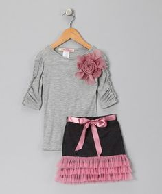Dress it up with Mary janes or pink strappy sandals. Dress it down and make it playful with pink converse sneakers or black kiddie ankle boots
