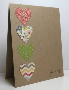 luv this simple kraft card with its row of patterned paper hearts forming a line down the side...attached by sewing down the middle of the hears...