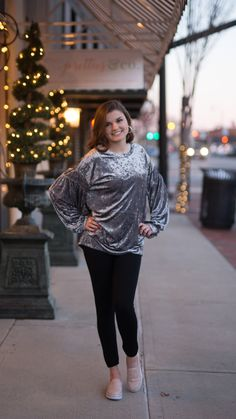 We've got all the Vanilla Ice feels with this crushed velvet balloon sleeve top!