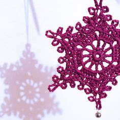 They're heeeeeeeere! Beautiful crochet snowflakes with tinkling bells in a variety of colours.  Perfect christmas tree ornaments!