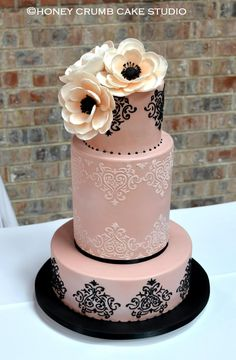 Blush pink and black wedding cake with sugar anemones. www.honeycrumb.com
