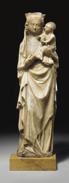 A CARVED ALABASTER GROUP OF THE VIRGIN AND THE CHILD, FRENCH, 14TH CENTURY STYLE