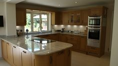 Traditional contemporary solid oak shaker kitchen in Woking Surrey with River Valley white granite worktops. Designed & fitted by Orchardkitchens.com in Egham