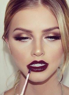 Golden eyes + wine lips