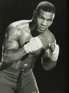 A young Mike Tyson - Flatpins. Tyson Boxer, Mike Tyson Boxing, American Boxer, Pete Rock, Boxing Posters, Photo Star, Boxing History, Champions Of The World, Boxing Champions