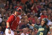 Brandon Allen #31 of the Oakland Athletics scores in the second inning as Jarrod Saltalamacchia #39 of the Boston Red Sox defends the plate at Fenway Park August 26, 2011 in Boston, Massachusetts.