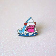 This terrifyingly adorable enamel pin.