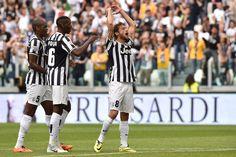 Claudio Marchisio (R) of Juventus celebrates their third goal during the Serie A match between Juventus and Cagliari Calcio at Juventus Aren...