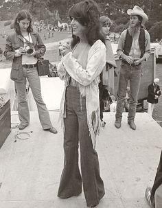 Grace Slick 1975.  High-waisted flares, fringe jacket, bangs.