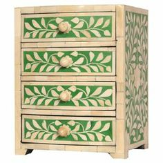 Crafted from a mix of camel bone and Indian rosewood, this chest features 4 drawers and a vine leaf design. Team with a dark wood bookcase and a coloured glass lamp to create an Art Nouveau study.  Product: Mini chest of drawersConstruction Material: Camel bone, Indian rosewood and resinColour: Green and creamFeatures:  Vine leaf designFour drawersDimensions: 26 cm H x 20 cm W x 17 cm D Cleaning and Care: Clean with furniture polish and a soft cloth