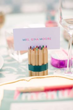 colored pencil place card holder, photo by Joielala, styling by Amorology Weddings http://ruffledblog.com/artsy-san-diego-wedding #weddingideas #placecards