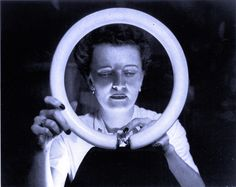 Woman with GE circline fluorescent lamp from 1945. #GE #lamp
