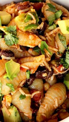 Taco Pasta Salad~ Can you see all that yummy-ness in there? Pasta Shells, black beans, corn, cilantro, avocado…