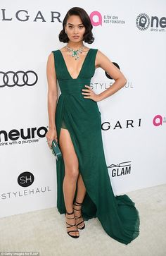 Go green in a flowing gown like Shanina Shaik. Click 'Visit' to buy now. #DailyMail