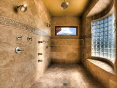 walk in shower - no door. Like the bench / shelf. Hate the glass cubes though.