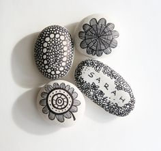 Stone doodles are VERY cool...some white paint and a black marker and you can doodle away on a rock!