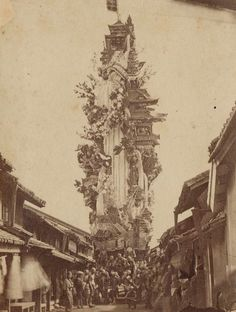 The photo above was taken by an unknown photographer in 1871, a mere 30 years after the world's first photographs began emerging. The artist captured a massive, precarious float (known as dashi) parading through the streets of Hakata, in Southern Japan.